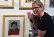 Mrs. Julie Krueger, AP Art Teacher at Cloverleaf High School, at the student showcase with Diana's self portrait