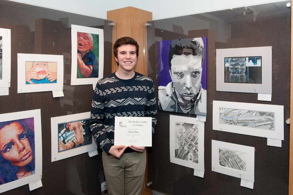 Zachary Batey and his artwork display