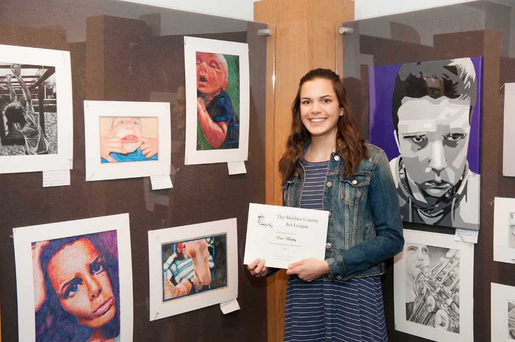 Erin Murphy and her artwork display