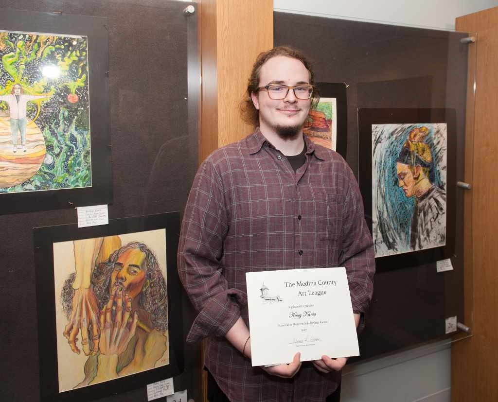 Kasey Kania and his artwork display