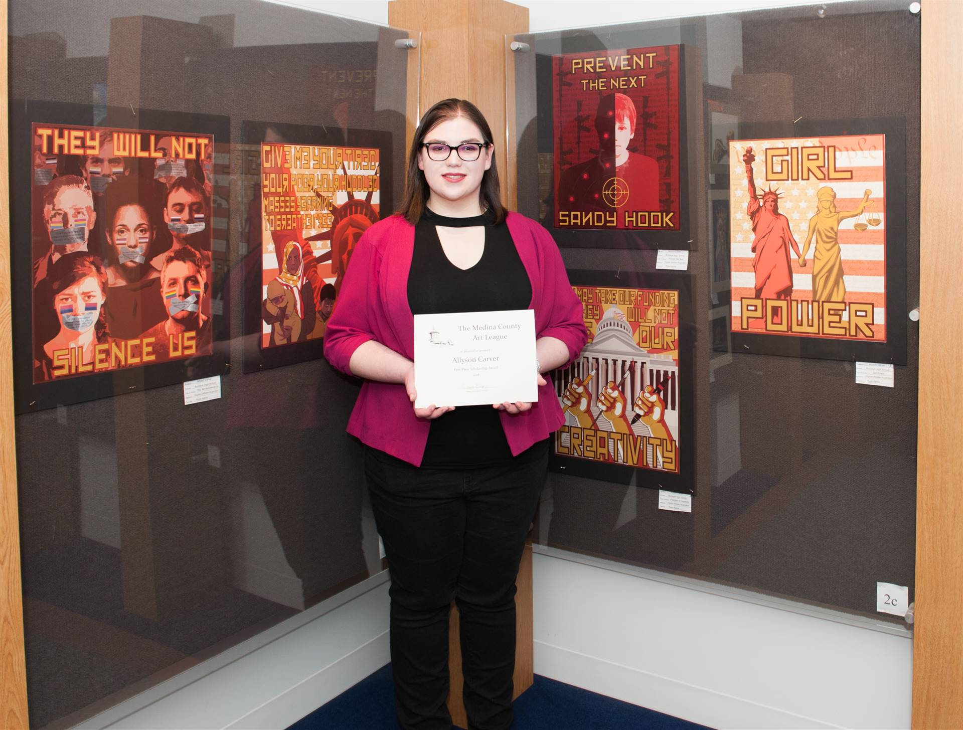 Allyson Carver and her artwork display