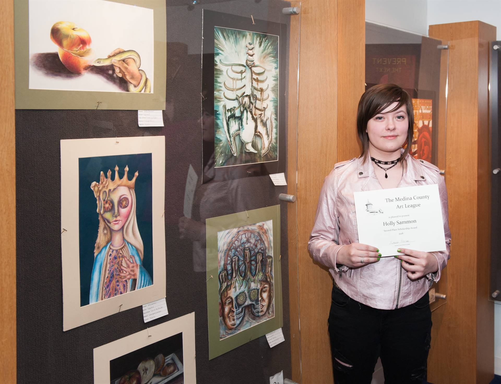 Holly Sammon and her artwork display