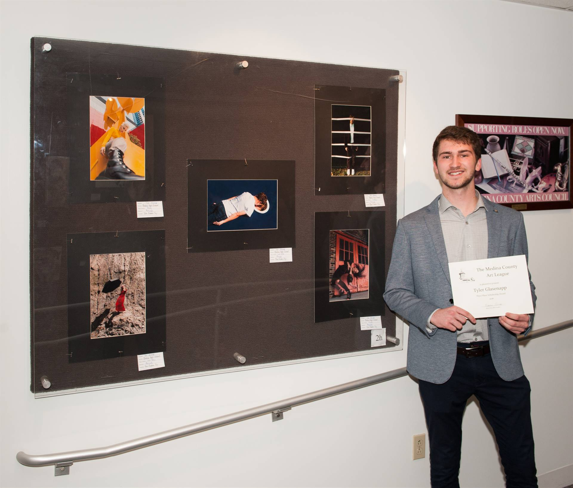 Tyler Glasenapp and his artwork display