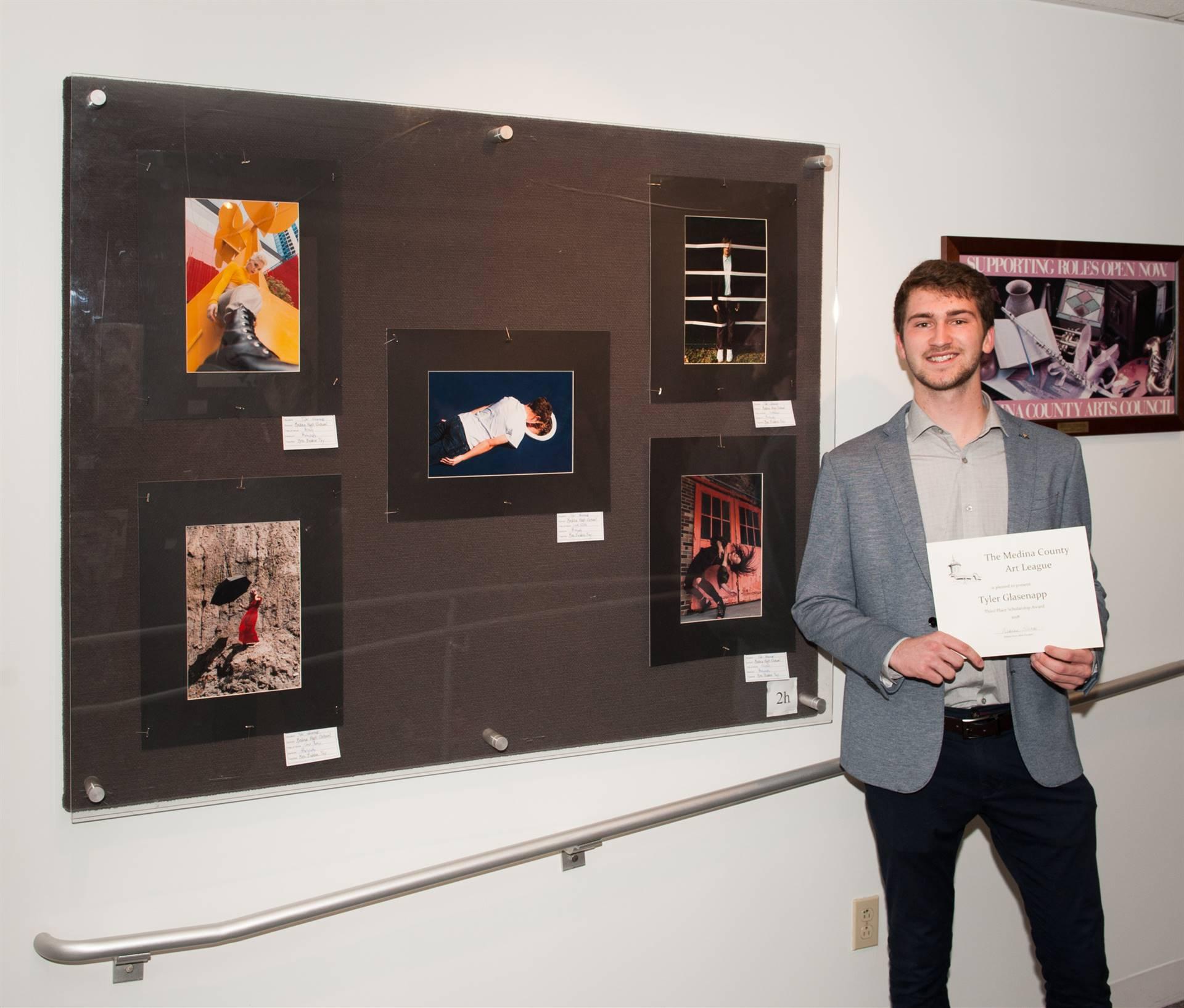 Tyler Glasenapp and his artwork display