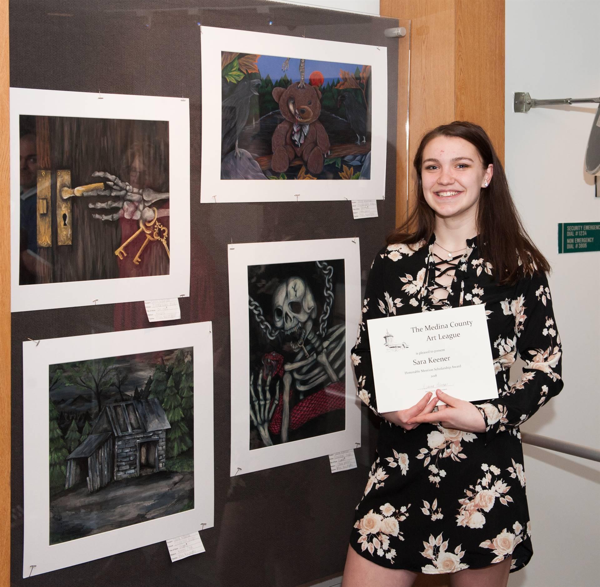 Sara Keener and her artwork display