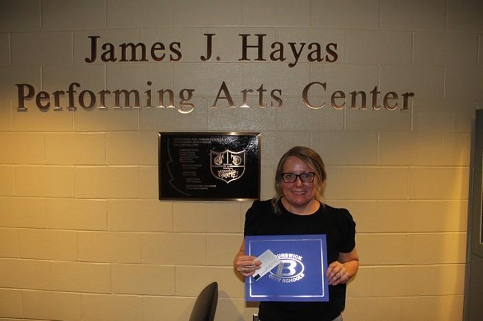 Sandra Collins LPN receiving a Brunswick Pride Award from Brunswick School District.
