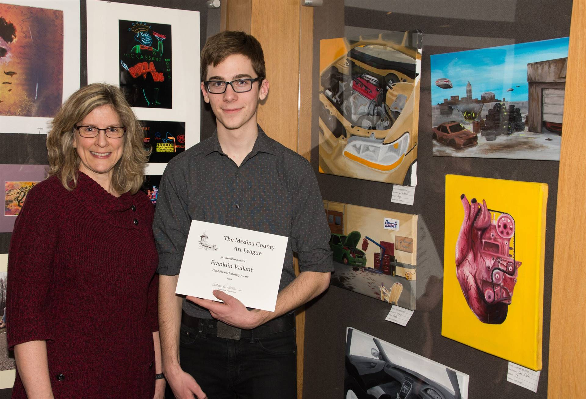 Frank Vallant, Third Place 2019 MCAL Scholarship Winner, with Julie Krueger, art teacher