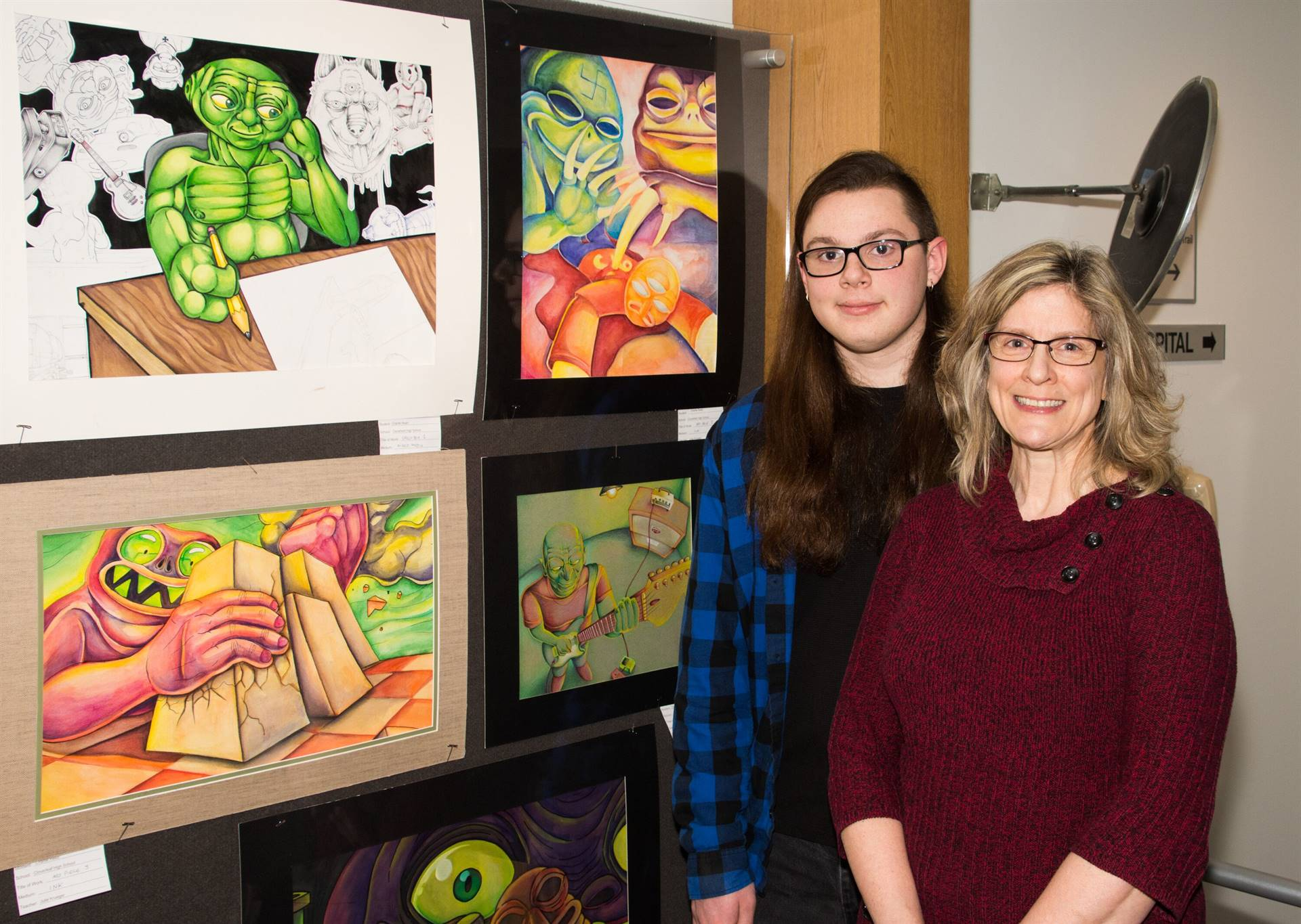 Charlie Reed, First Place 2019 Non-Scholarship Portfolio Winner, with Julie Krueger, art teacher